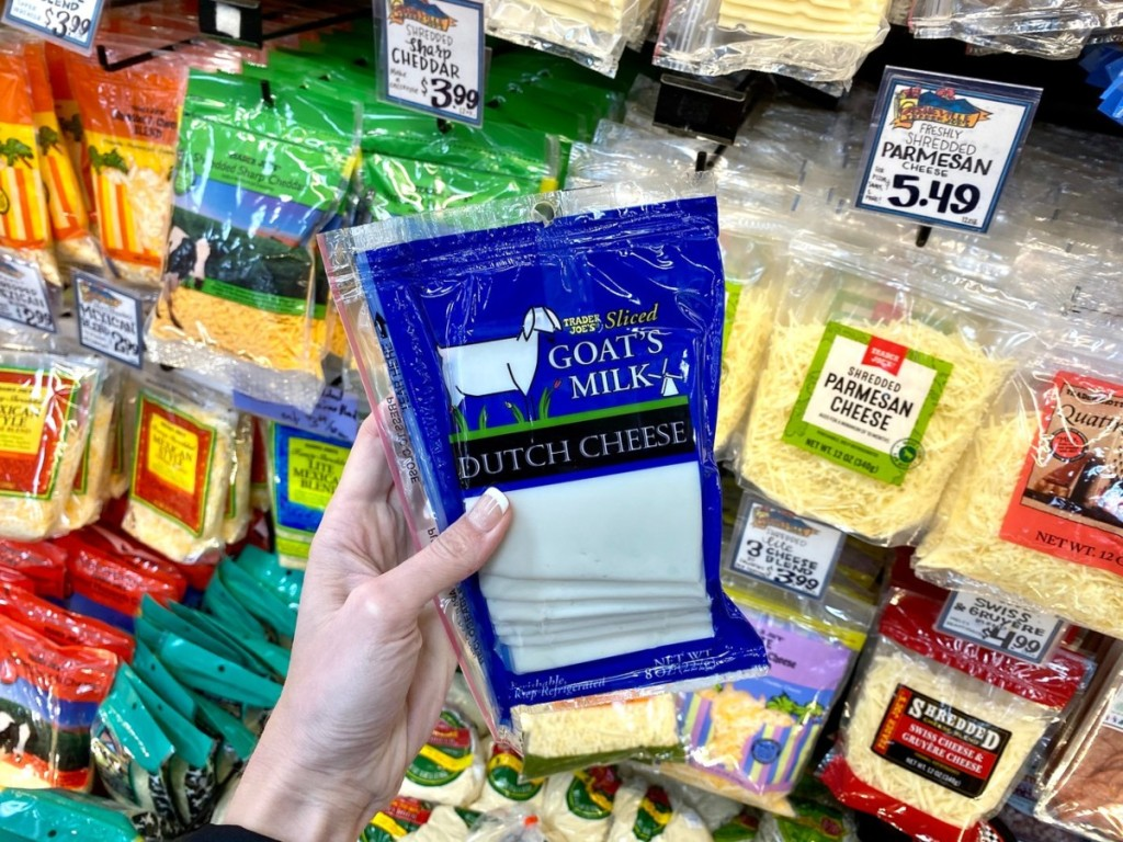 holding goat's milk cheese slices at Trader Joe's