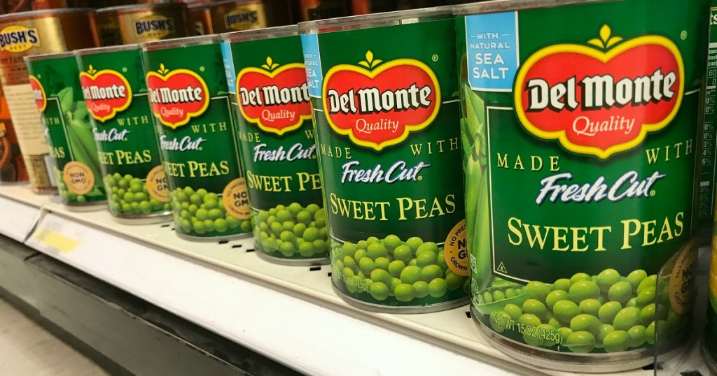row of cans of delmonte green peas
