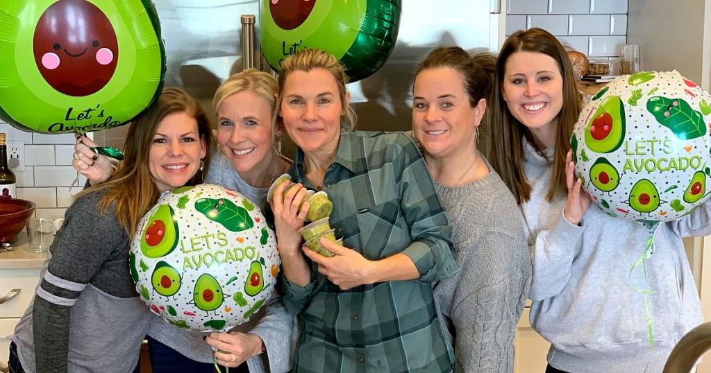 hip2keto team holding avocado balloons