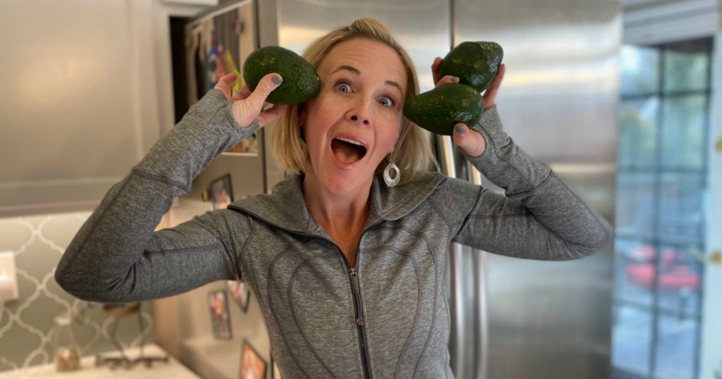 woman being funny holding avocados to her head