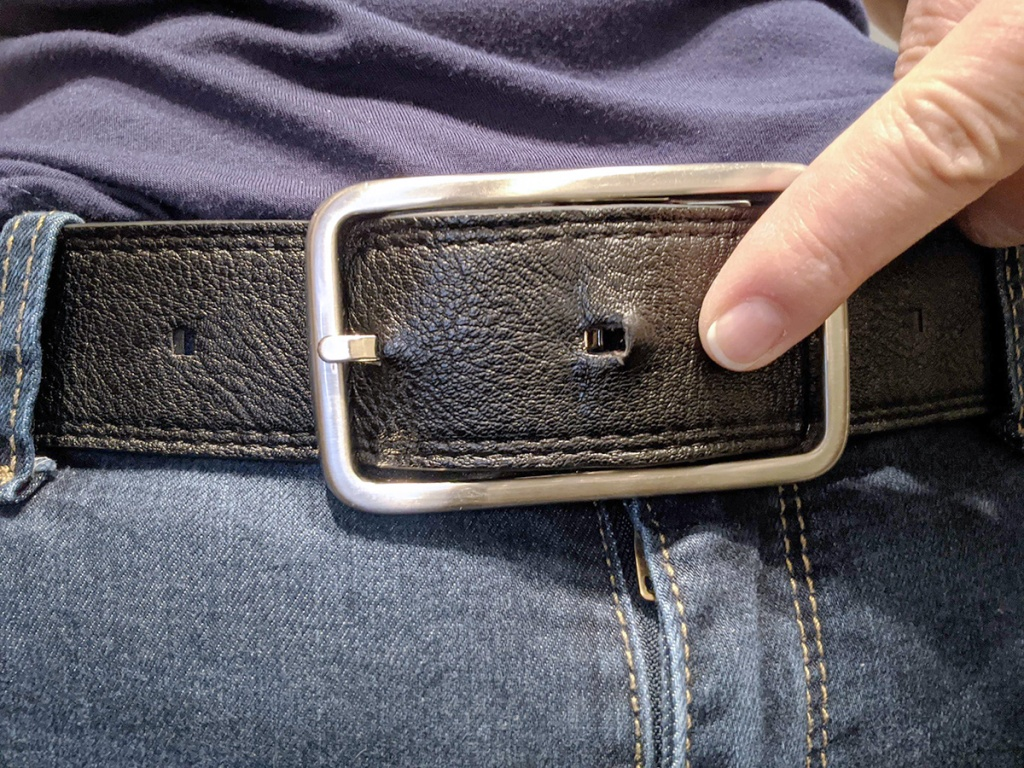 belt notch being tightened from weight loss