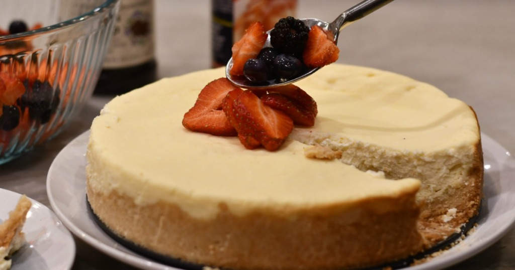 easy keto cheesecake recipe on a platter with strawberries on top