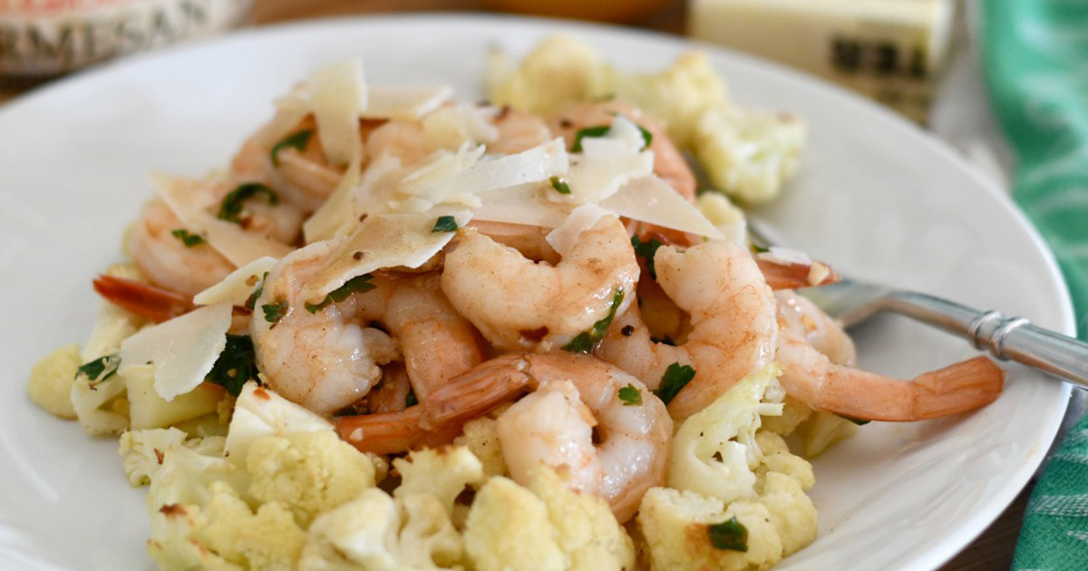 A dish loaded with delicious shrimp and cauliflower scampi topped with parmesan cheese