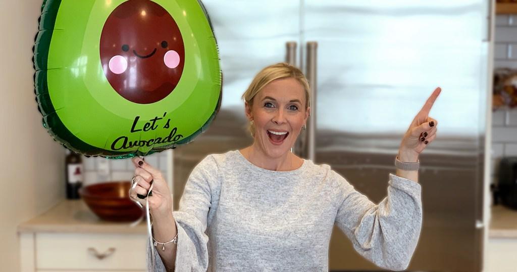 collin holding lets avocado balloon