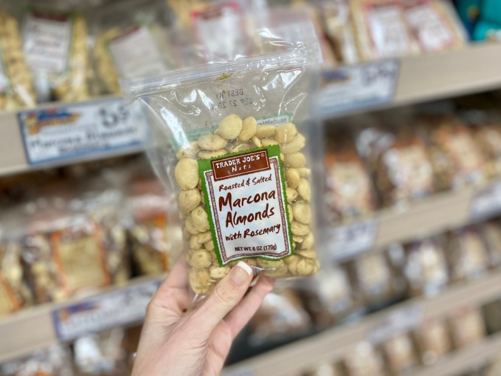 holding Marcona almonds at Trader Joe's