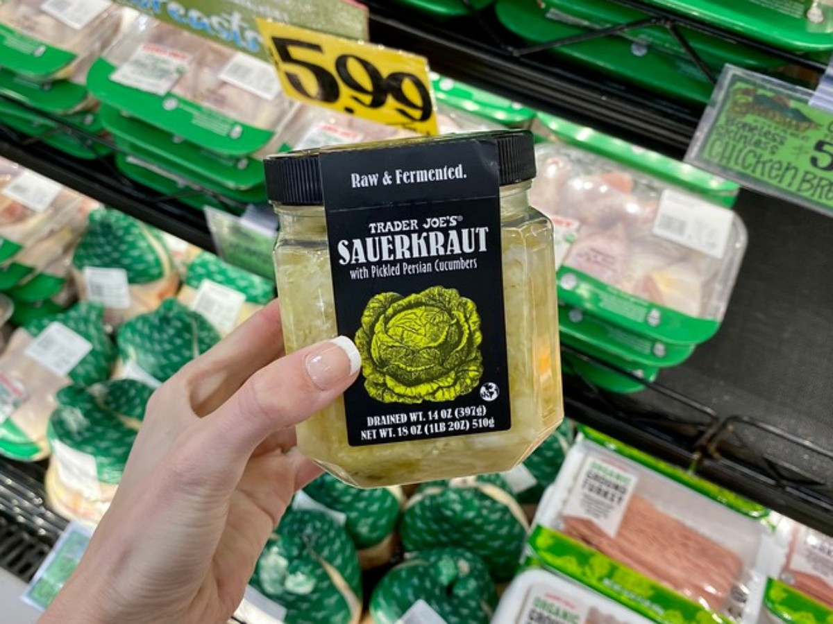 holding jar of Sauerkraut