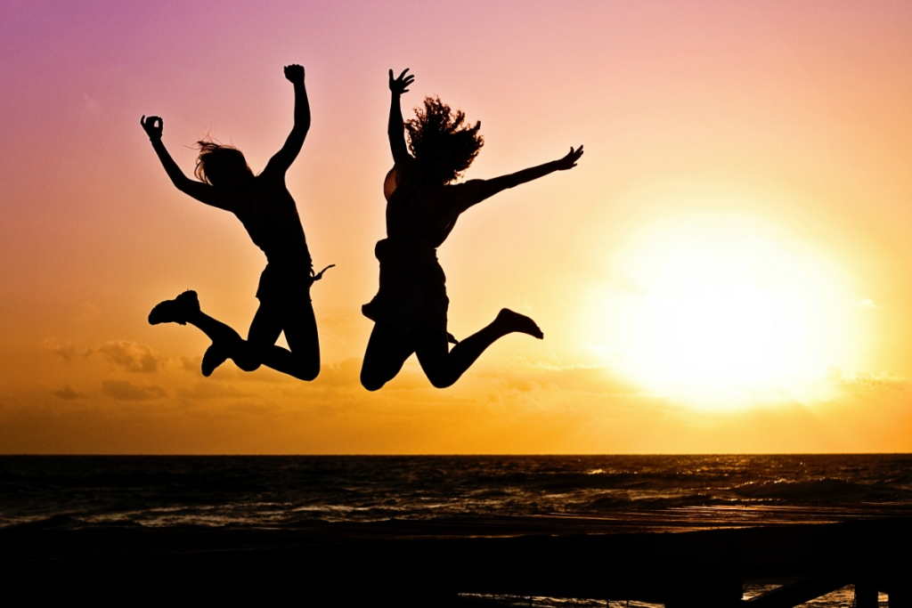 two people jumping in air