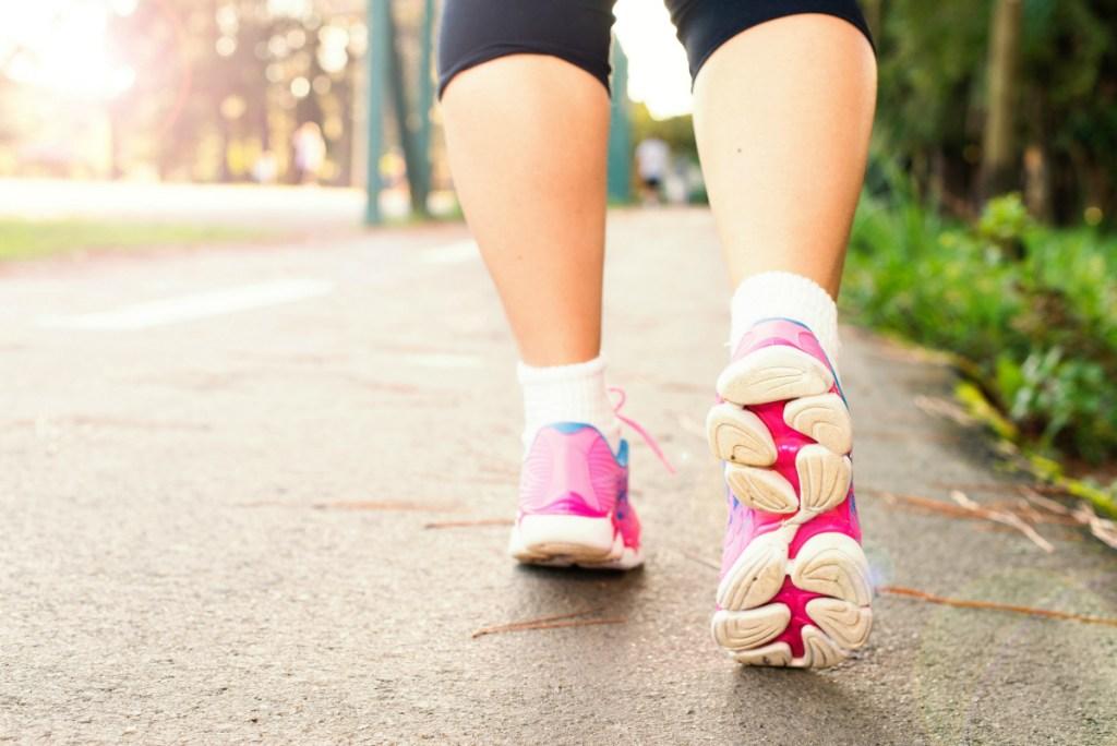 woman walking on pavement