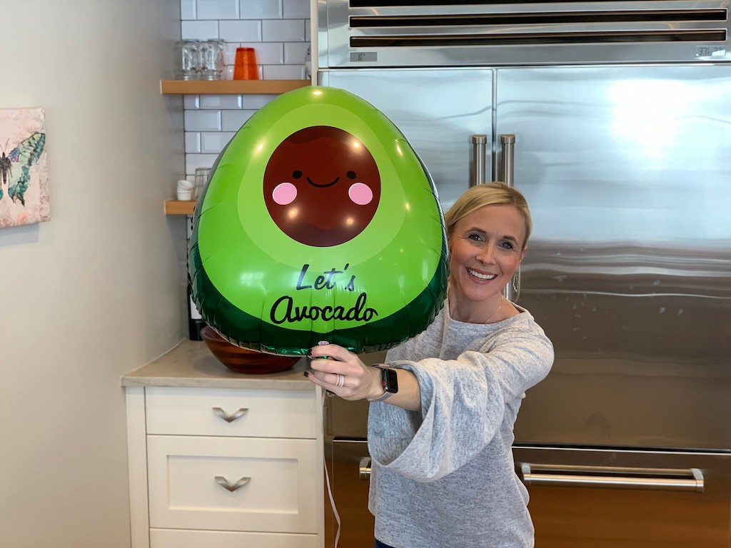 collin holding avocado balloon