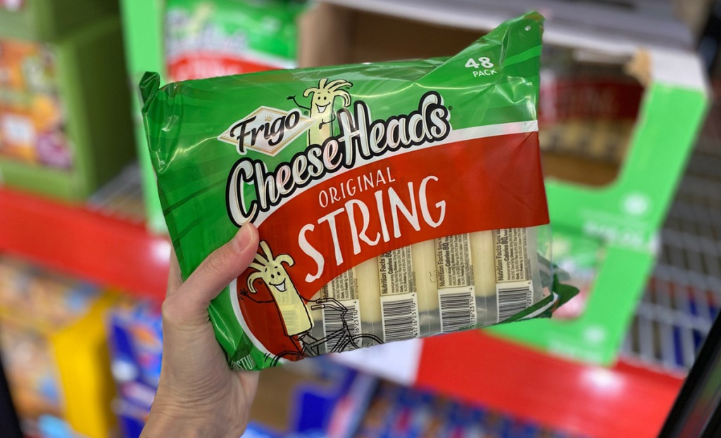 hand holding bag of frigo string cheese