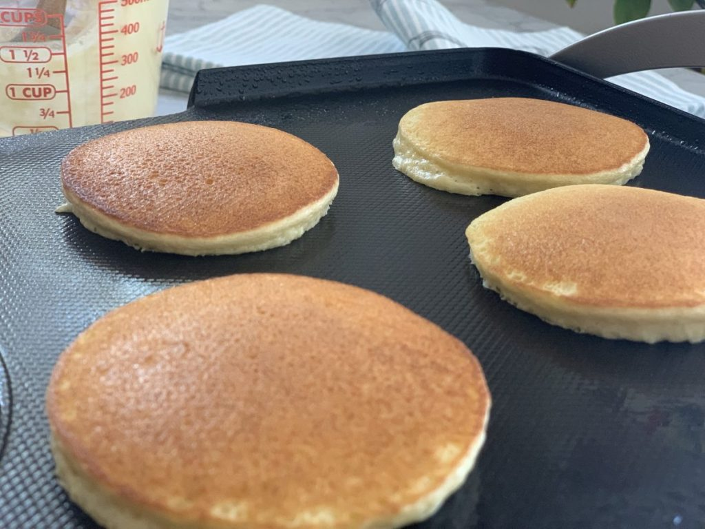 4 pancakes on a griddle