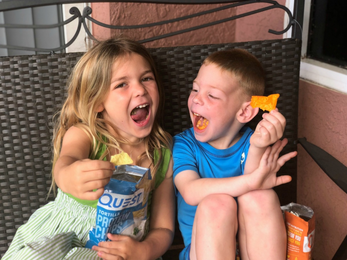happy kids eating Quest protein chips