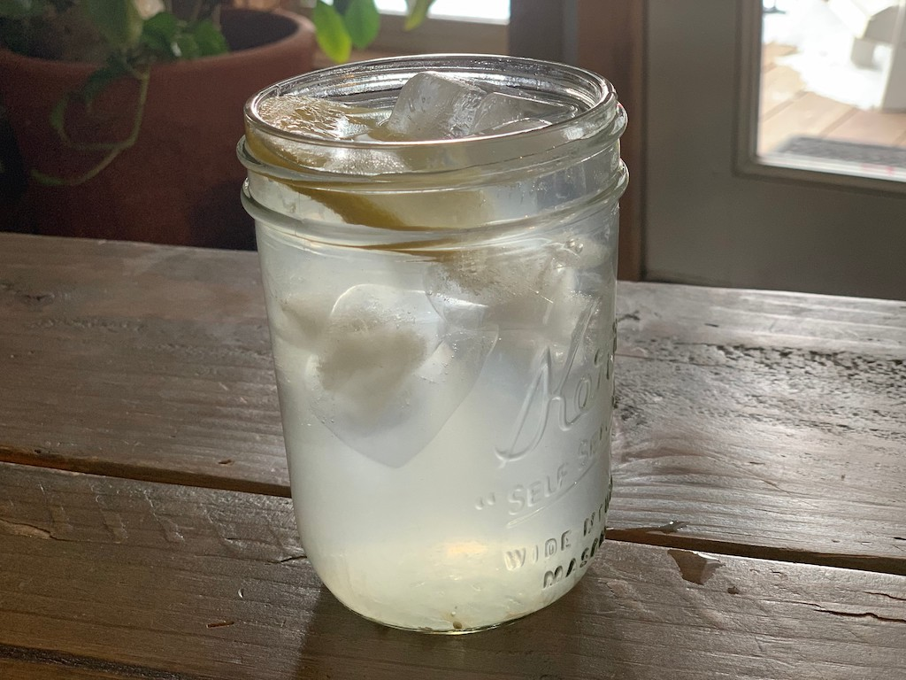 mason jar with water and lemon slice