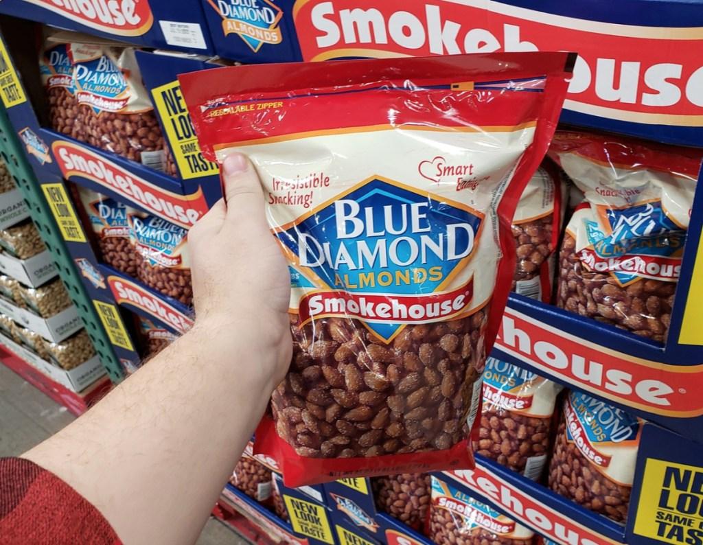 holding a bag of Blue Diamond Smokehouse Almonds
