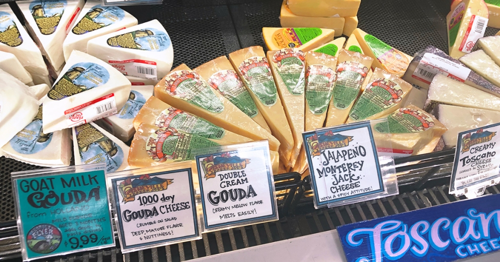 gouda cheese and brie in cheese section at trader joes
