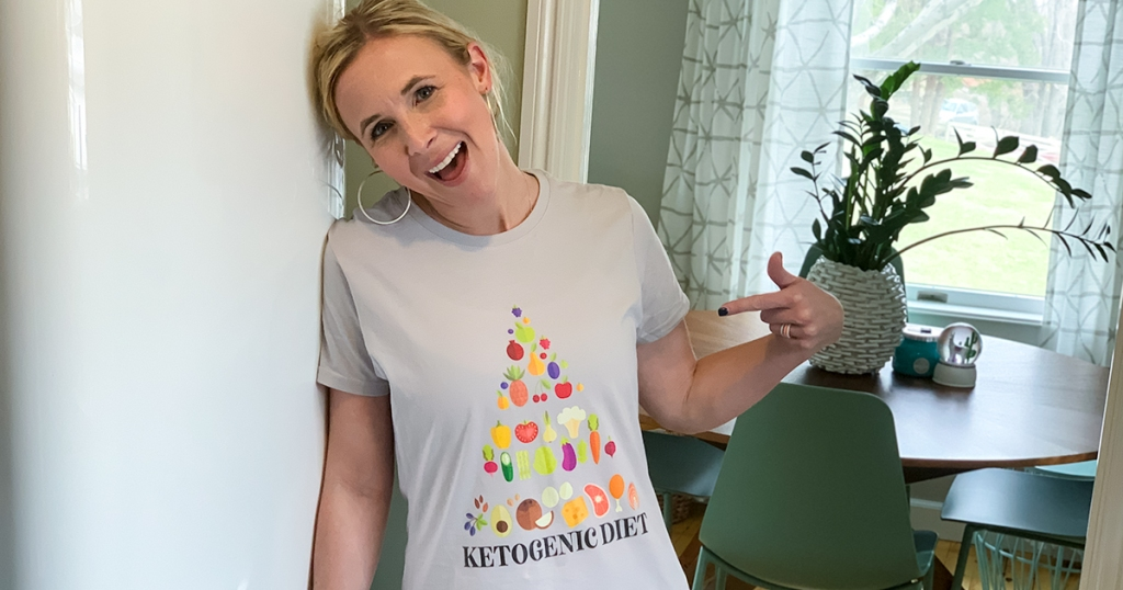 woman wearing t-shirt with keto diet pyramid graphic on front