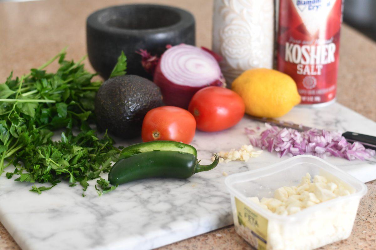 ingredients on counter for keto avocado feta salsa