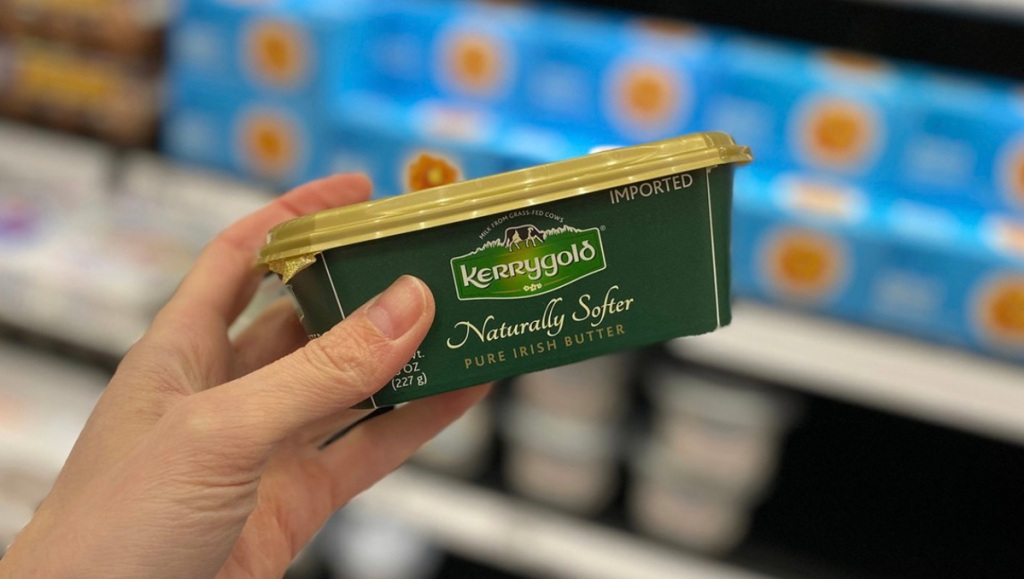 hand holding tub of kerrygold butter