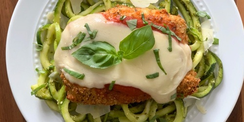 Low-Carb Oven Baked Chicken Parmesan Over Pesto Zoodles