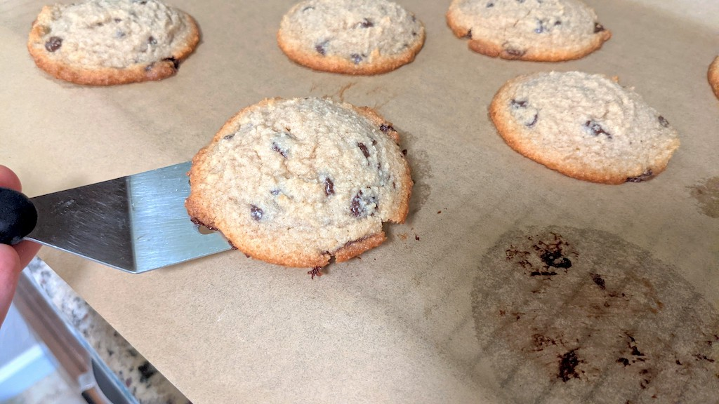 taking chocolate chip cookie off pan