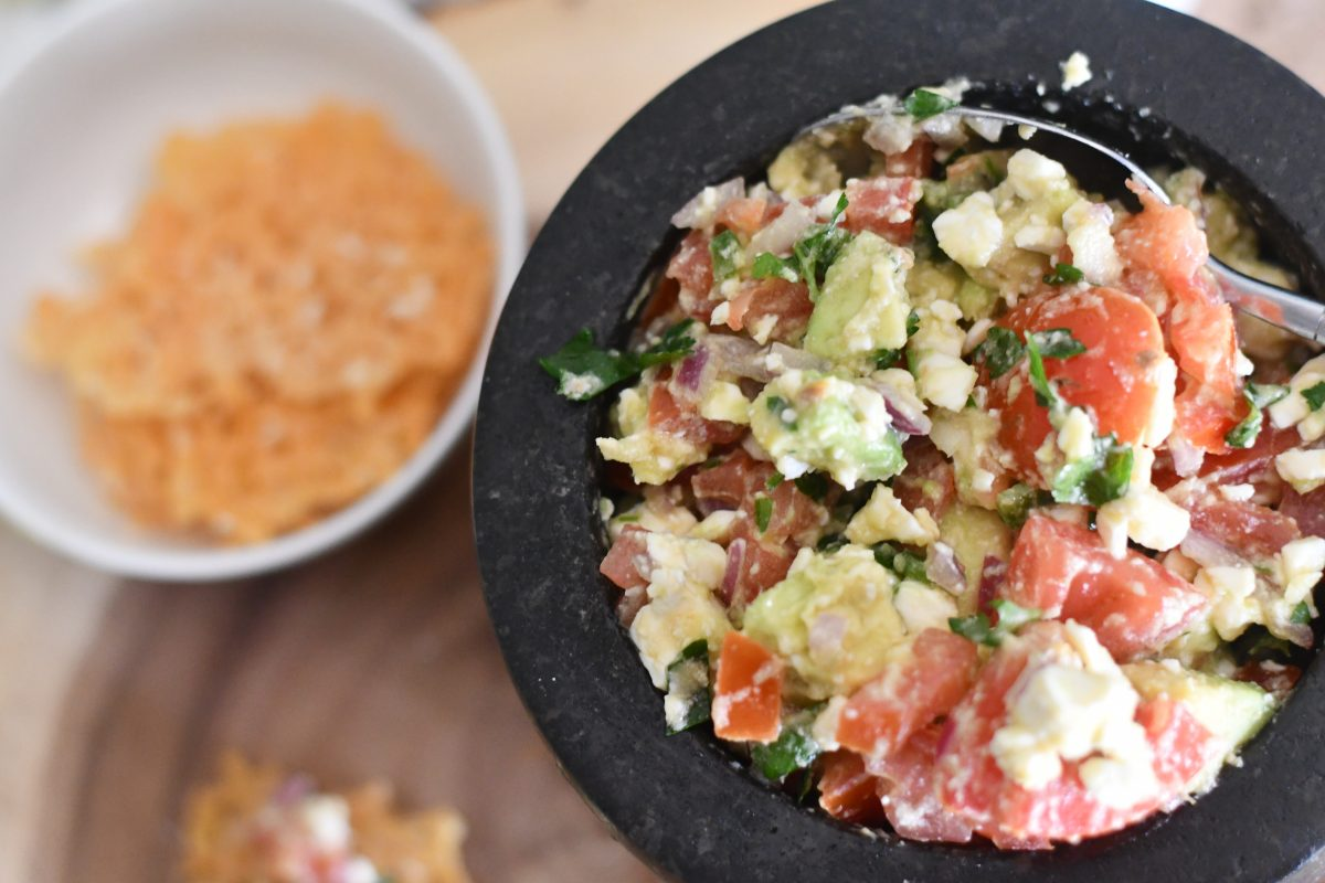 keto avocado feta salsa served up with cheese wisp crackers