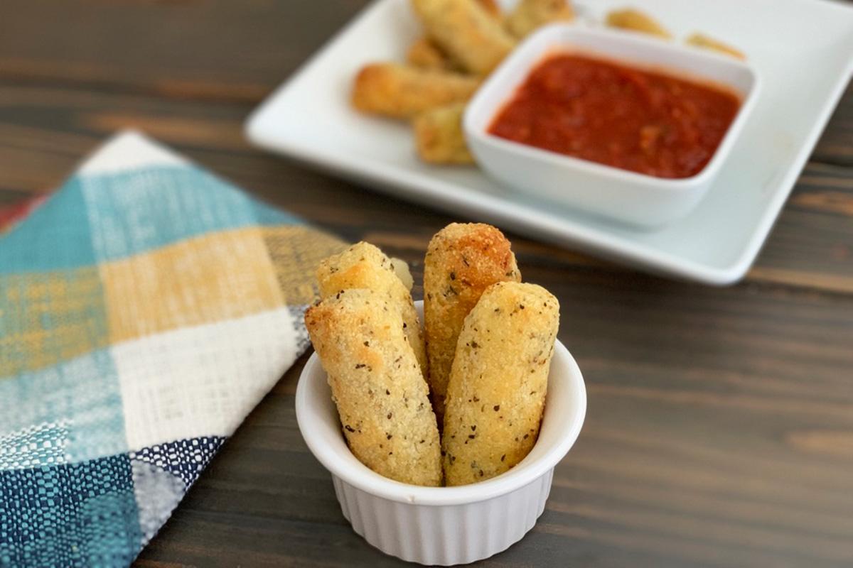 A serving of keto fried mozzarella sticks in a small dish