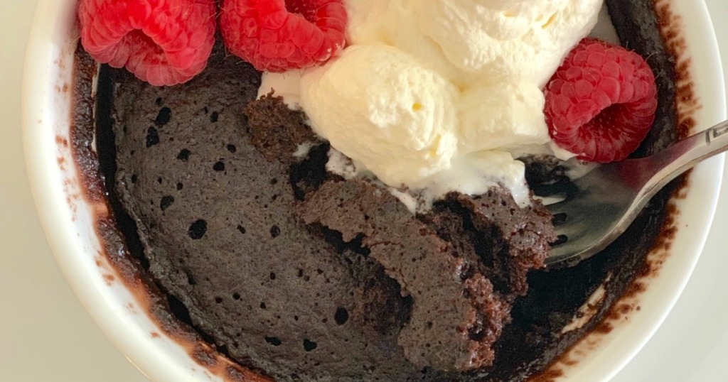 keto chocolate mug cake with whipped cream and berries