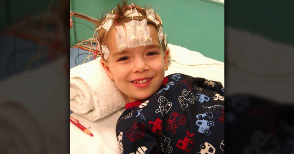 young boy smiling in hospital
