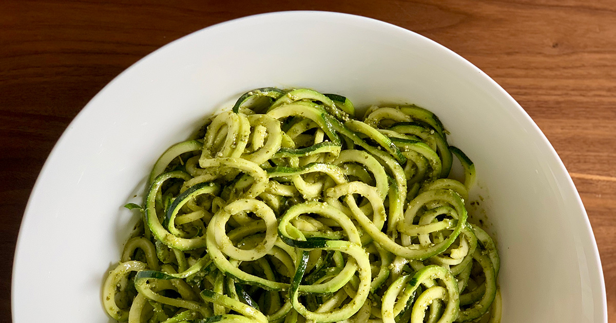 a large bowl of pesto zoodles