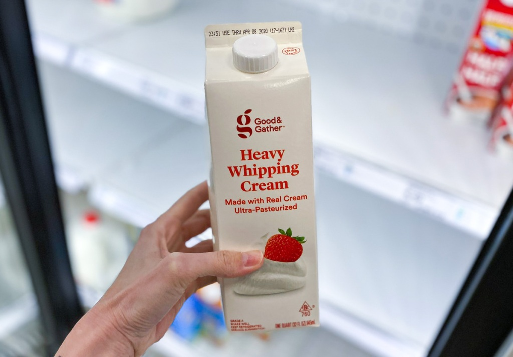 hand holding target heavy whipping cream