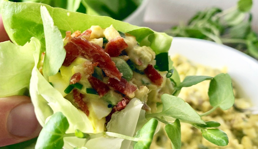 bacon avocado egg salad wrapped in lettuce with watercress