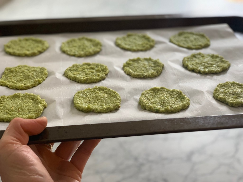 keto avocado chips on pan going into oven