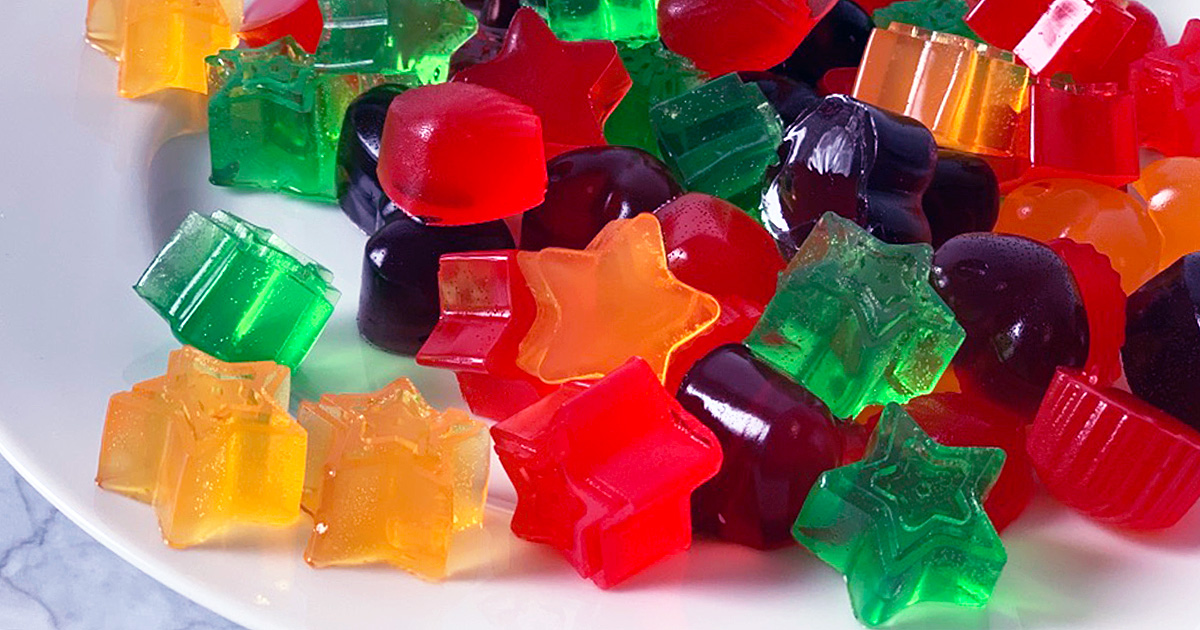 a plate of very colorful jello jiggler shapes