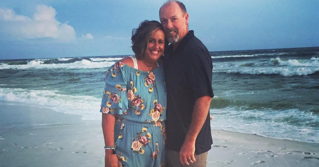 candi and husband on the beach