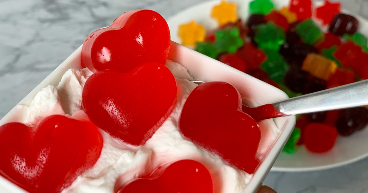 heart shaped jello jigglers in a small dish of whipped cream