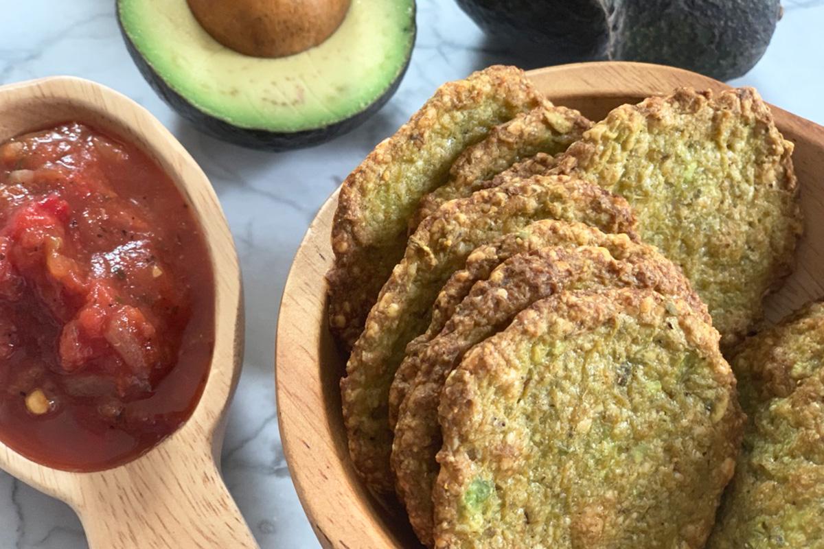 avocado chips served alongside salsa and fresh avocado