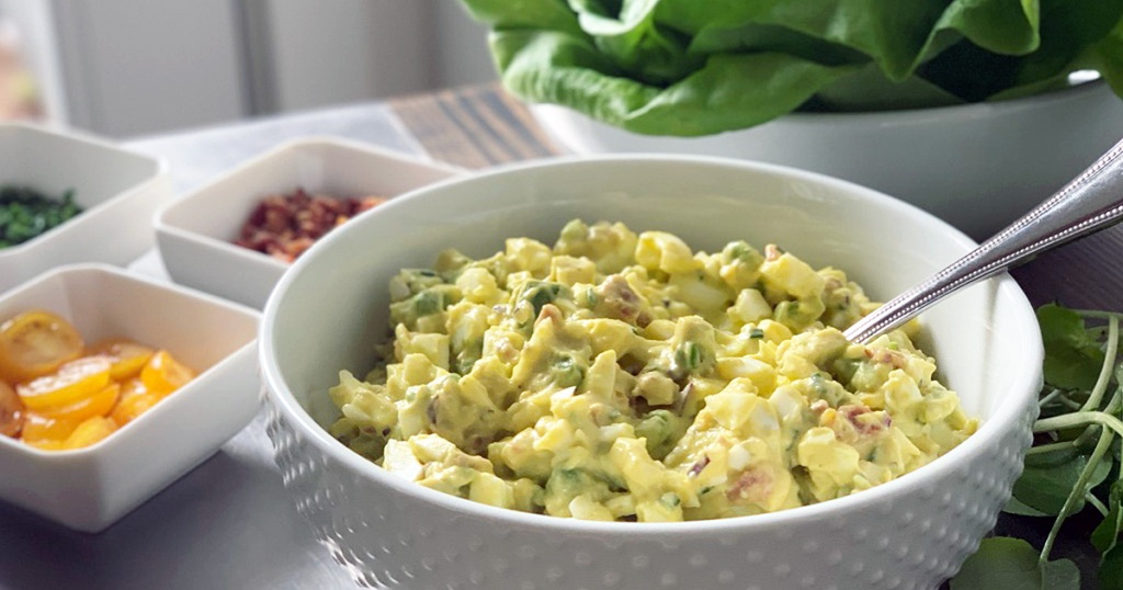 a serving bowl of bacon avocado and egg salad