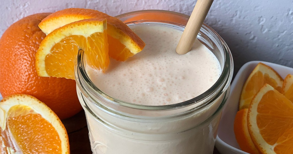 keto orange julius copycat in a jar with oranges