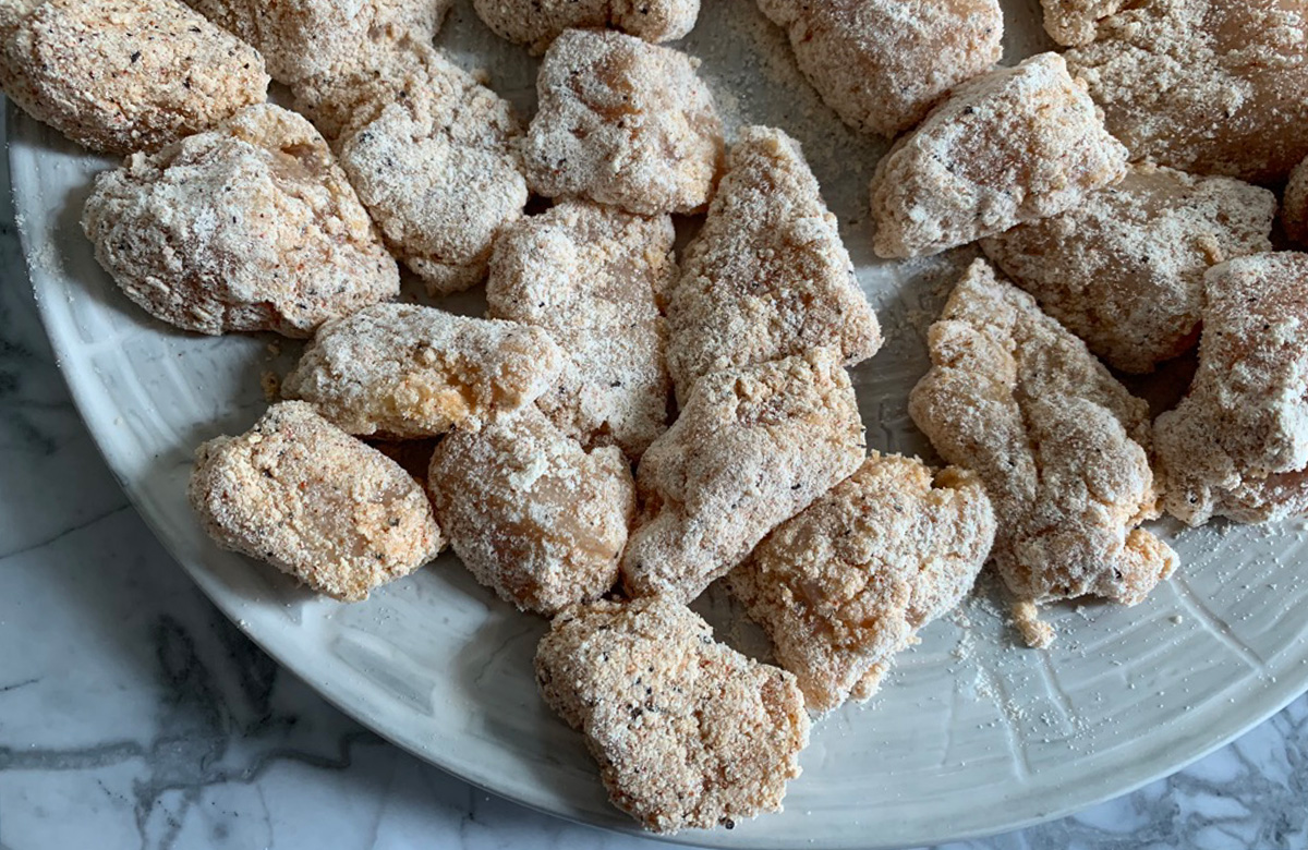 chicken bites coated with whey protein powder and seasonings