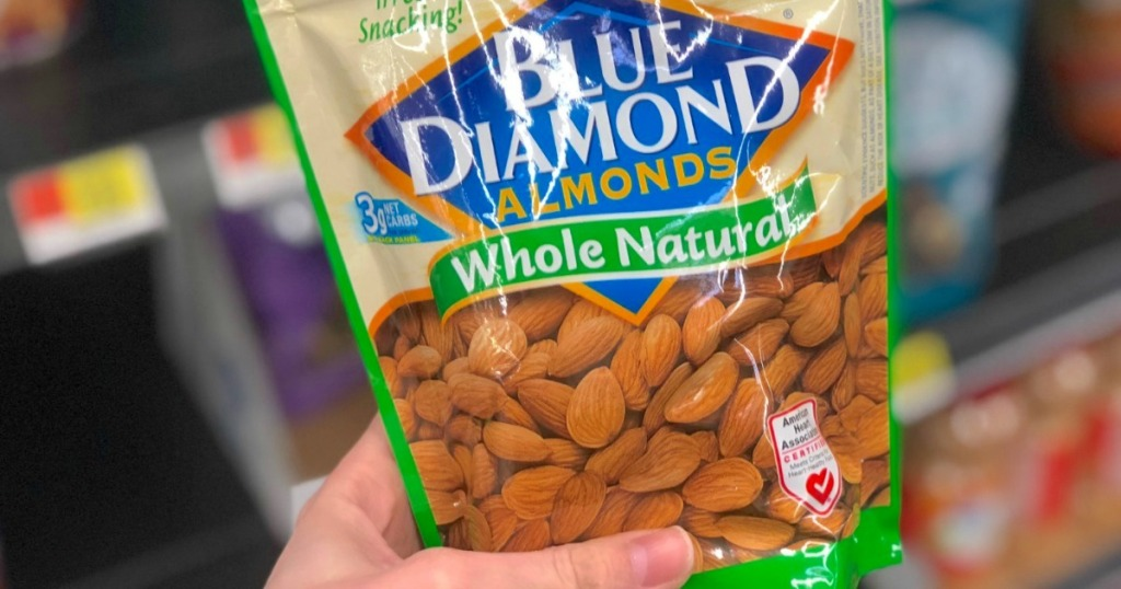 hand holding blue diamond almonds