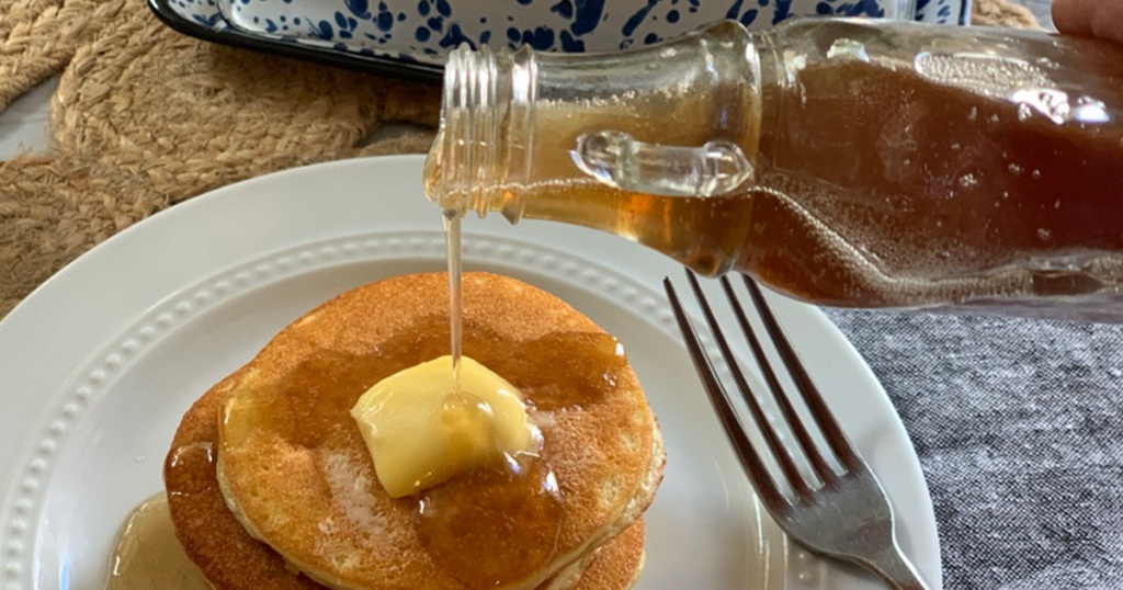 yummy sugar-free syrup being poured onto keto pancakes