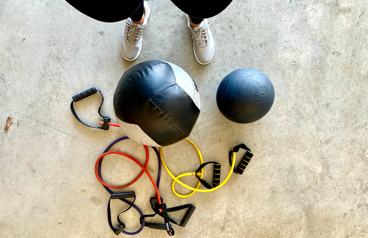 Find Your Trainer Session with medicine ball, bands, and other portable gym equipment