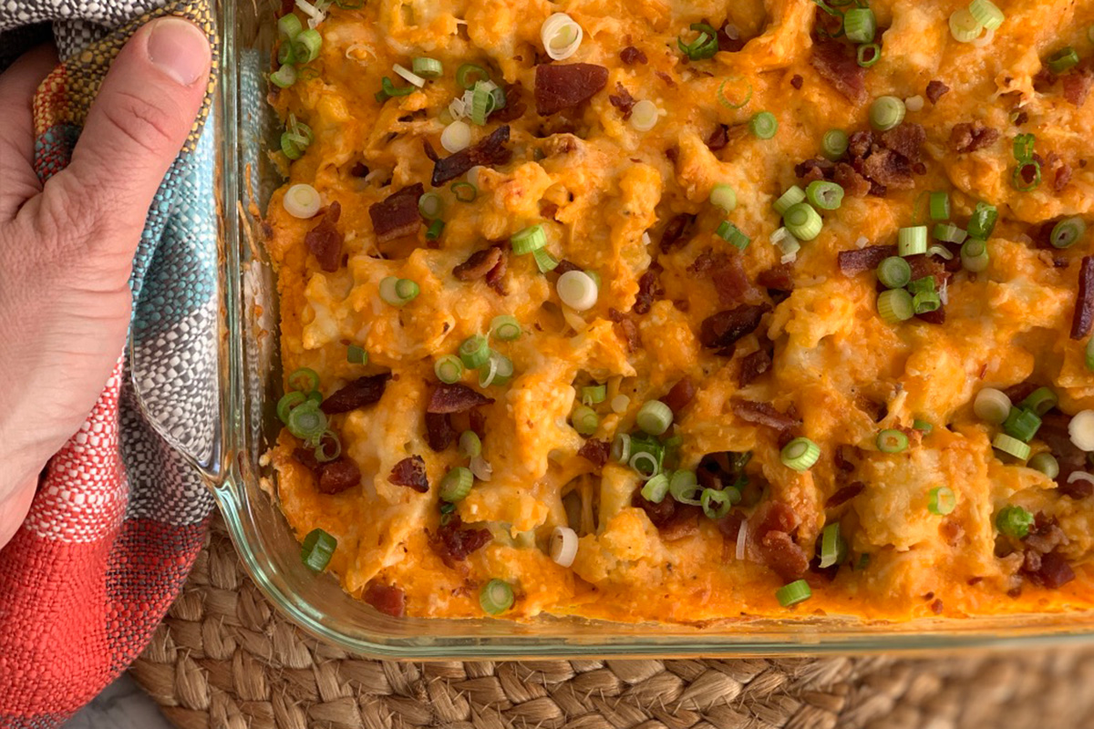 a serving dish with ready to eat low-carb Buffalo chicken casserole