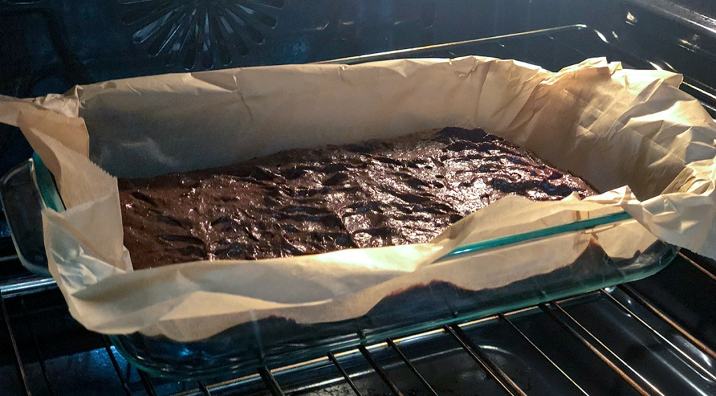 fudgy keto brownies — brownies in pan cooking in the oven