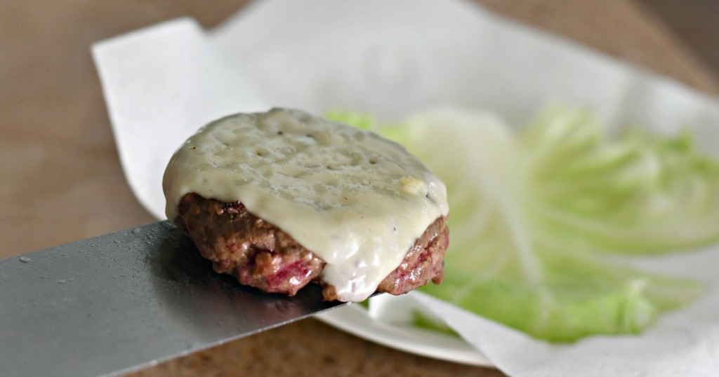 burger with havarti cheese wrapped in cabbage