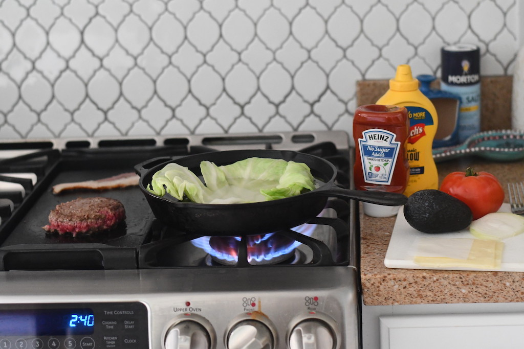 cooking keto burger and cabbage on the stove
