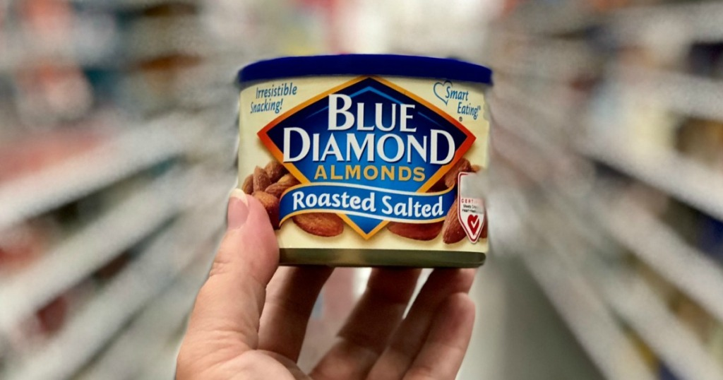 holding can of salted Blue Diamond almonds