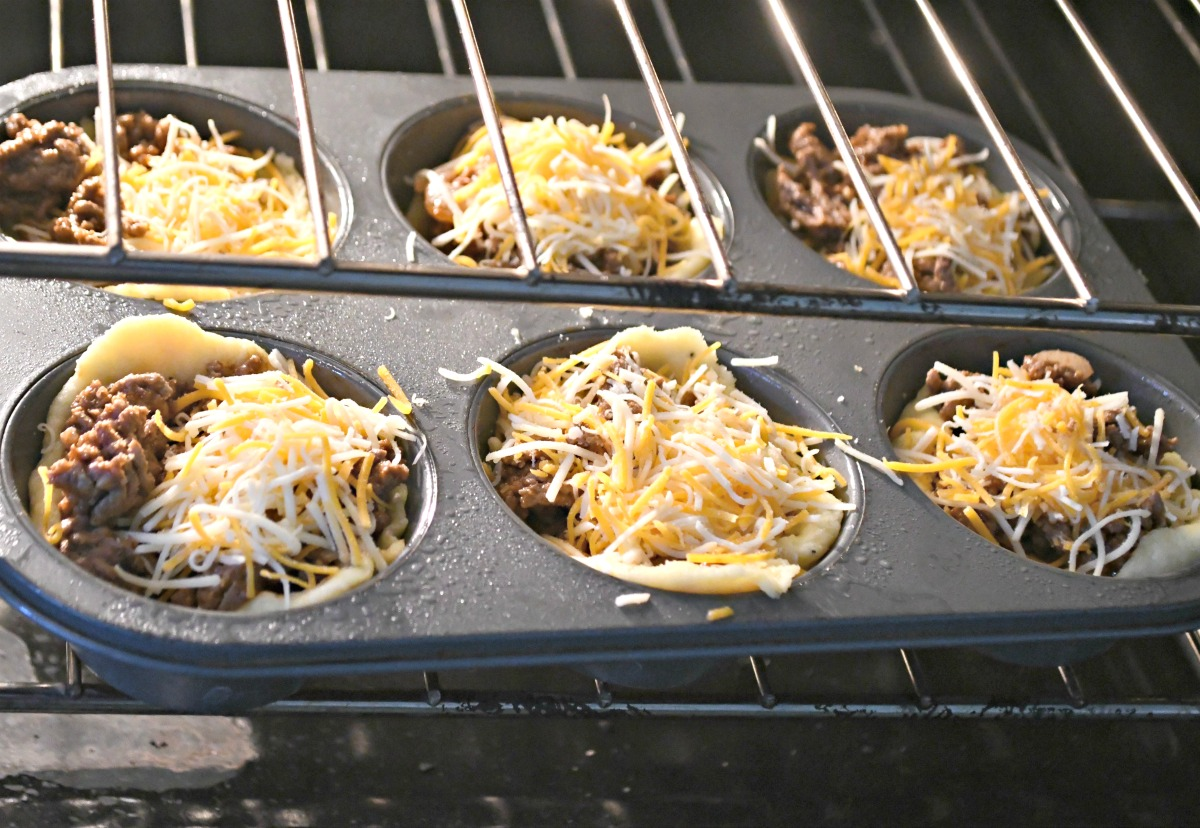 keto cheeseburger muffins in the oven