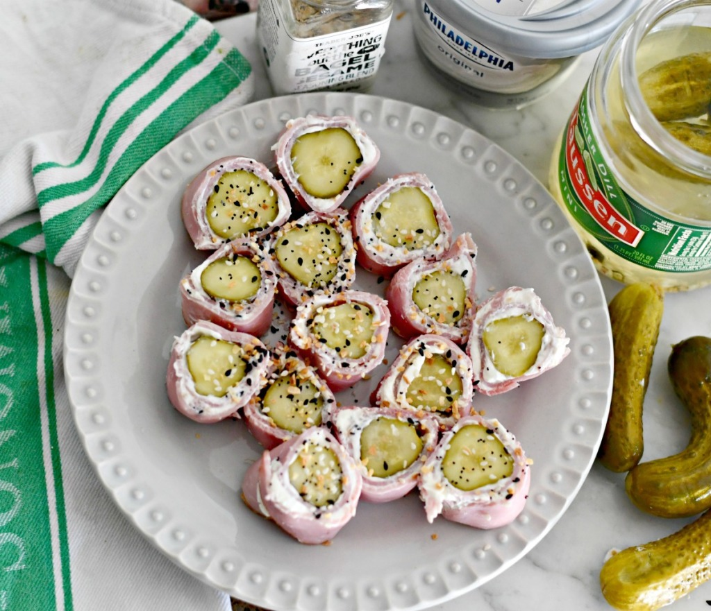 top view of keto pickle roll ups on a plate