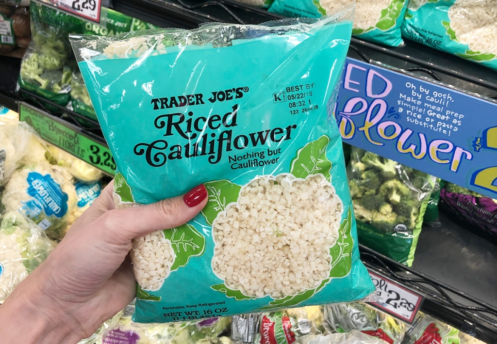 bag of riced cauliflower in produce section at trader joe's